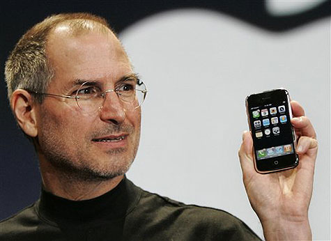 Steve Jobs shows the original iPhone.